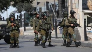 İsrail güçleri ikisi çocuk 13 Filistinliyi gözaltına aldı
