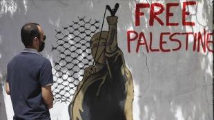Yunan sanatçı Nemer, Filistin'e destek için grafiti yaptı